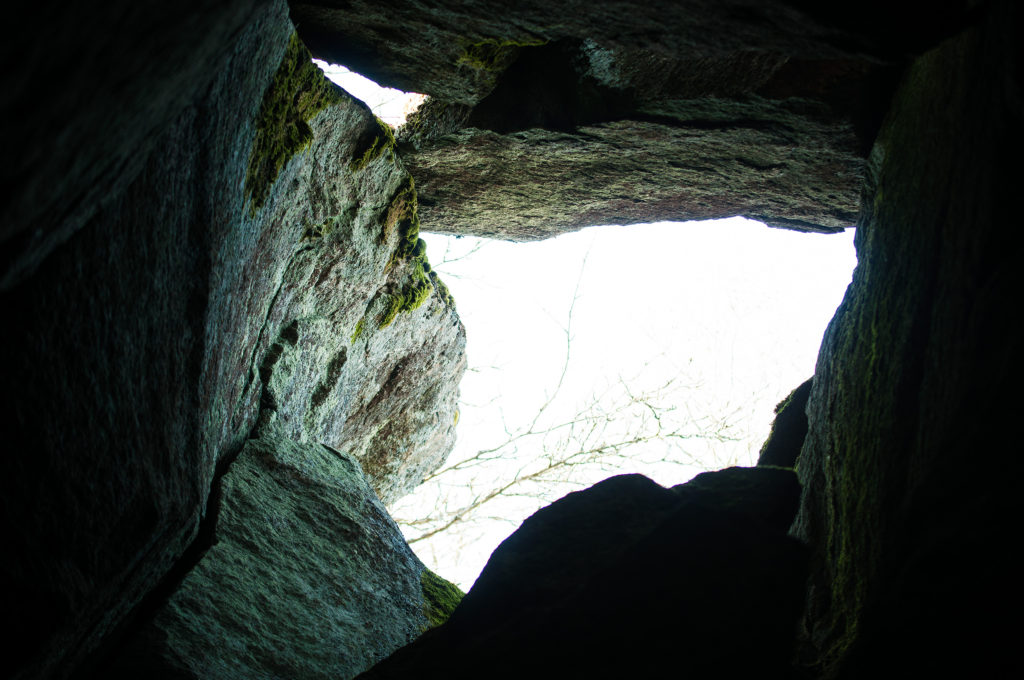 A view from bottom of a cave to the sky.